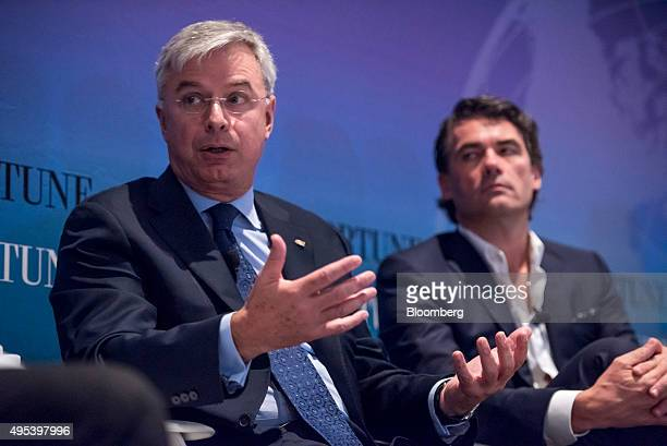 Hubert Joly chairman and chief executive officer of Best Buy Co Inc left speaks as Gavin Patterson chief executive officer of BT Group PLC listens...