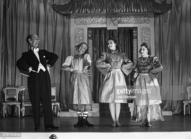 Hubert Tannar leads Princess Elizabeth and her sister Princess Margaret in a rehearsal for the pantomime 'Aladdin' at Windsor Castle UK December...