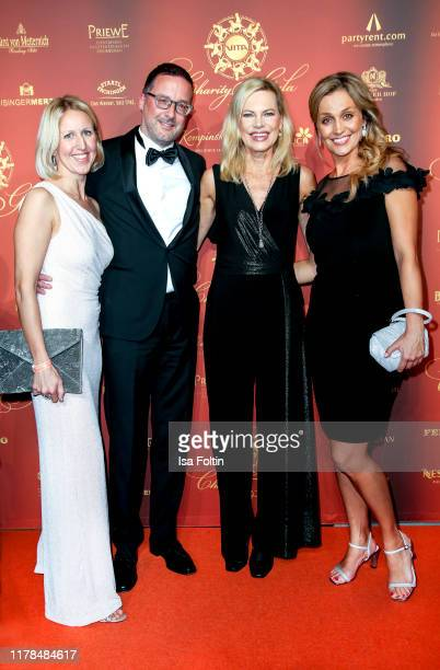 Hubert Wieser with his wife German presenter Nina Ruge and German presenter Sandra Maria Gronewald attend the 10th VITA Charity Gala at Kurhaus...