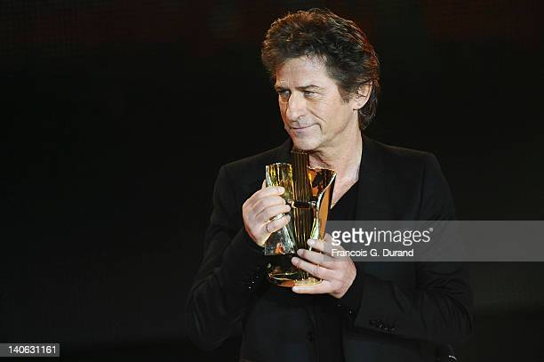 HubertFelix Thiefaine receives an award during 'Les Victoires de La Musique 2012' at Palais des Congres on March 3 2012 in Paris France