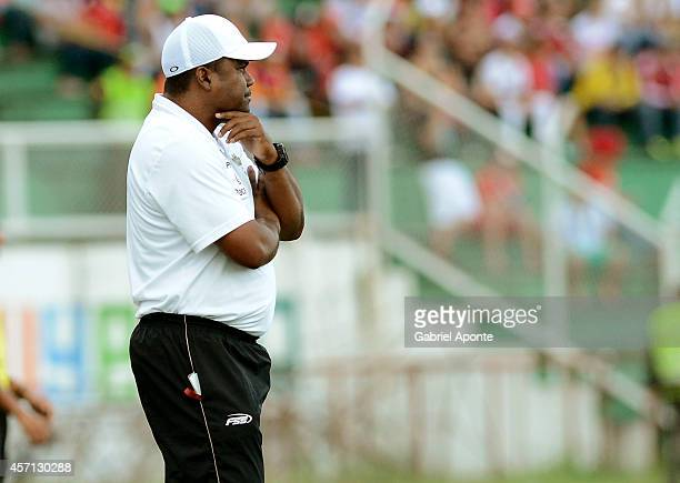 Huberth Bodhert Barrios head coach of Llaneros looks on during a match between America de Cali and Llaneros FC as part of Torneo Postobon 2014 II at...