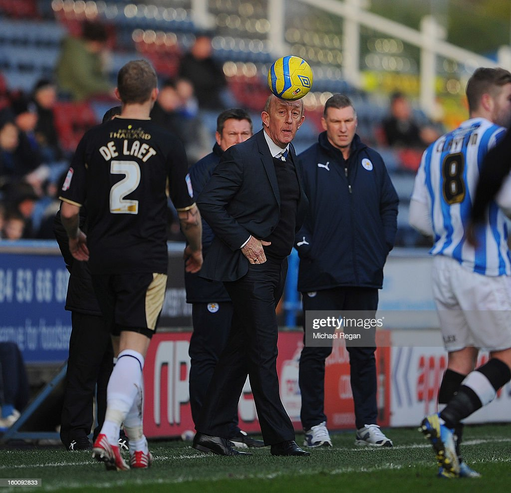 Huddersfield caretaker manager Mark Lillis heads the ball back into play as Leicester manager Nigel Pearson looks on during the FA Cup Fourth Round match between Huddersfield Town and Leicester City at the Galpharm Stadium on January 26, 2013 in Huddersfield, England.