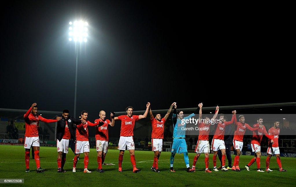 Huddersfield celebrate winning the Sky Bet Championship match between Burton Albion and Huddersfield Town at Pirelli Stadium on December 13, 2016 in Burton-upon-Trent, England.