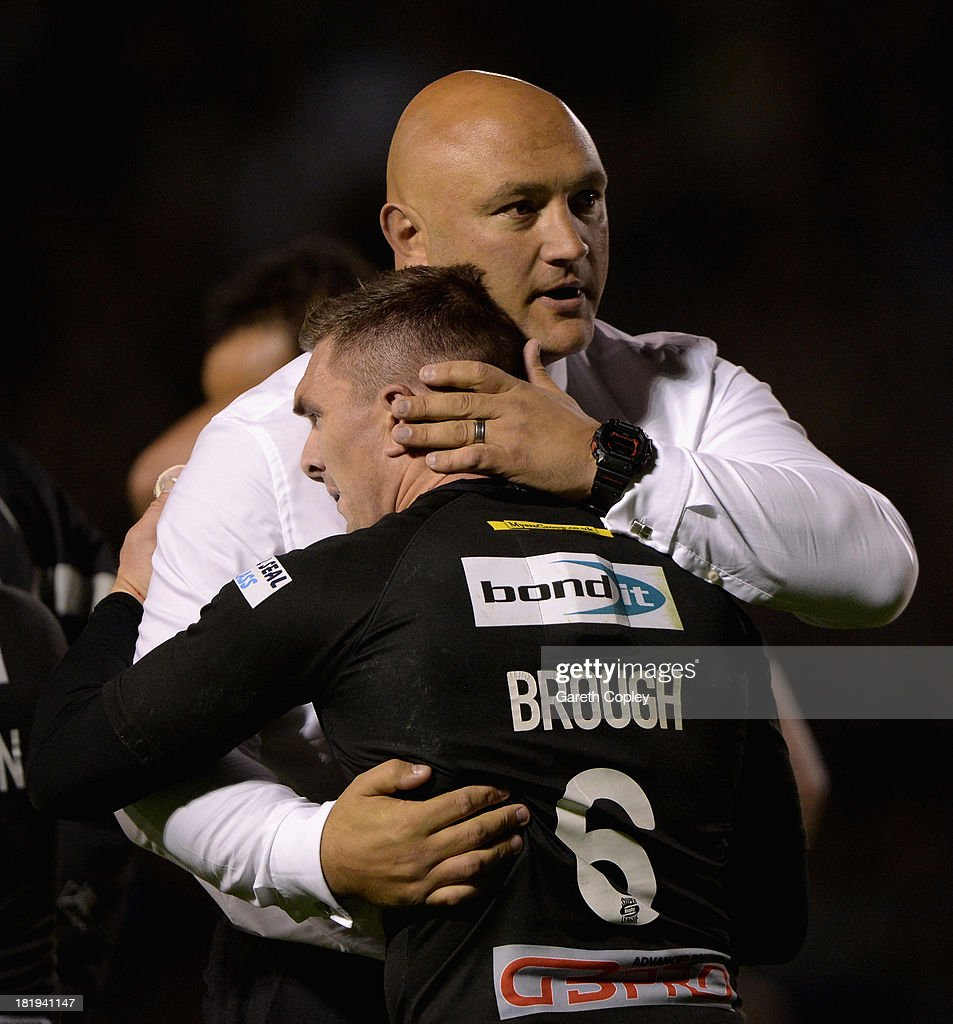 Huddersfield coach Paul Anderson consoles captain Danny Brough after losing the Super League Qualifying Semi Final between Warrington Wolves and Huddersfield Giants at The Halliwell Jones Stadium on September 26, 2013 in Warrington, England.