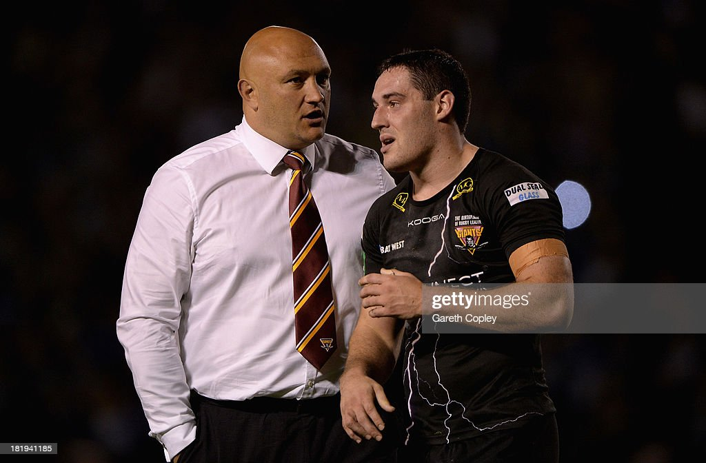 Huddersfield coach Paul Anderson consoles Joe Wardle after losing the Super League Qualifying Semi Final between Warrington Wolves and Huddersfield Giants at The Halliwell Jones Stadium on September 26, 2013 in Warrington, England.