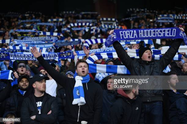 Huddersfield fans are seen ahead of kick off of the English Premier League football match between Huddersfield Town and Brighton and Hove Albion at...