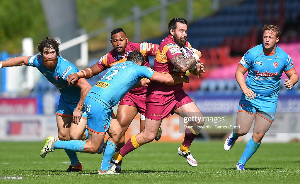 Huddersfield Giants' Craig Huby is tackled by St Helens' Jon Wilkin during the First Utility Super League Round 22 match between Huddersfield Giants and St Helens at the John Smith's Stadium on July 17, 2016 in Huddersfield, England.