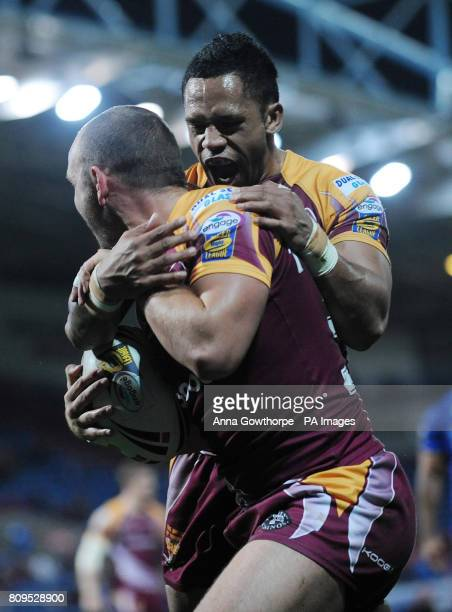 Huddersfield Giants Dale Ferguson celebrates with David Faiumu after scoring a try during engage Super League Play Off Match at the Galpharm Stadium...