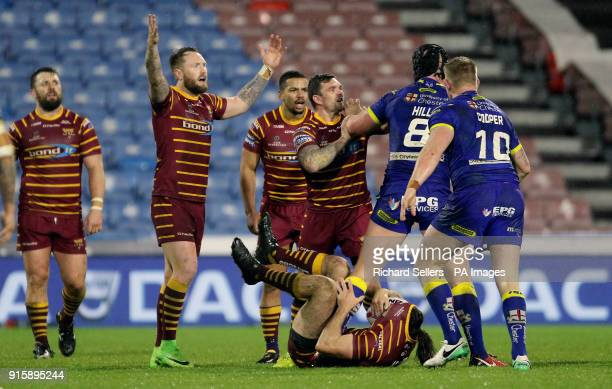Huddersfield Giants Danny Brough and Warrington's Chris Hill confront each other during the Betfred Super League match at the Kirklees Stadium...