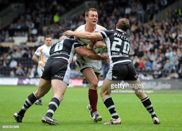 Huddersfield Giants' Darrell Griffin is tackled by Hull FC's Mark O'Meley and Cameron Phelps during the engage Super League match at the KC Stadium...