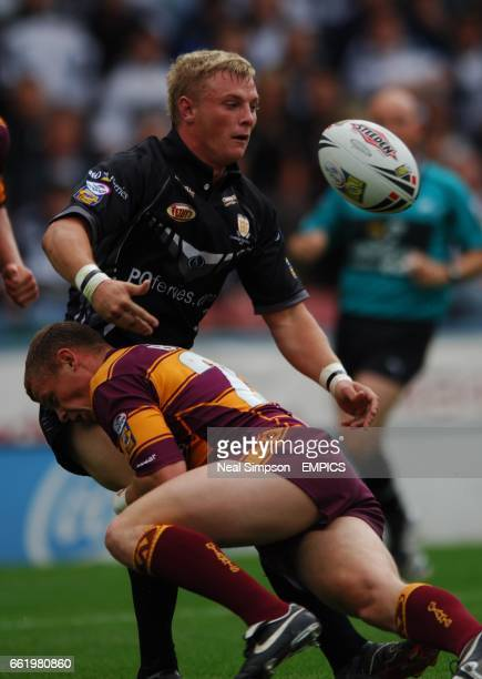 Huddersfield Giants' Kevin Brown tackles Hull FC's Horne