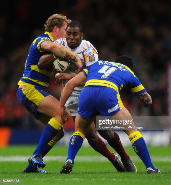 Huddersfield Giants' Michael Lawrence is tackled by Warrington Wolves' Chris Bridge and Chris Westwood during the Engage Super League match at the...