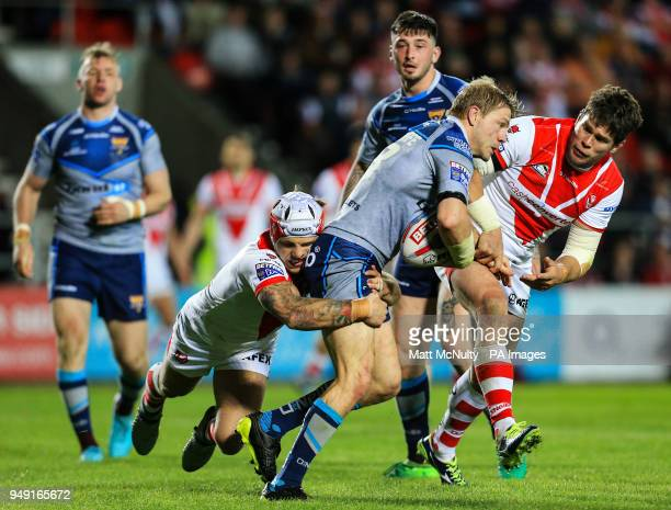 Huddersfield Giants' Ryan Hinchcliffe is tackled by St Helens' Alex Walmsley during the Betfred Super League match at the Totally Wicked Stadium St...