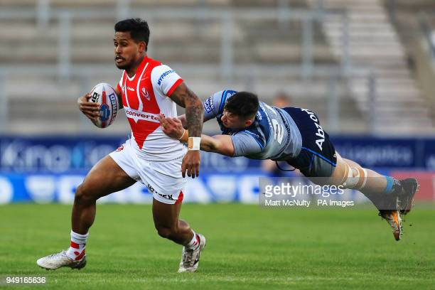 Huddersfield Giants' Sam Wood tackles St Helens' Ben Barba during the Betfred Super League match at the Totally Wicked Stadium St Helens
