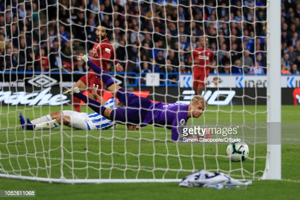 Huddersfield goalkeeper Jonas Lossl looks back helplessly as Mohamed Salah of Liverpool scores their 1st goal during the Premier League match between...