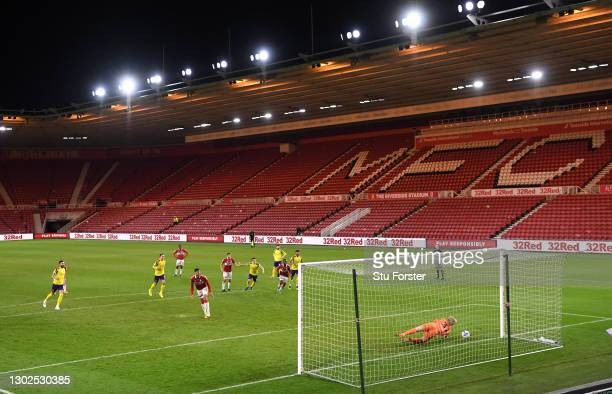 Huddersfield goalkeeper Ryan Schofield is beaten by the penalty kick of Ashley Fletcher for the second Boro goal during the Sky Bet Championship...