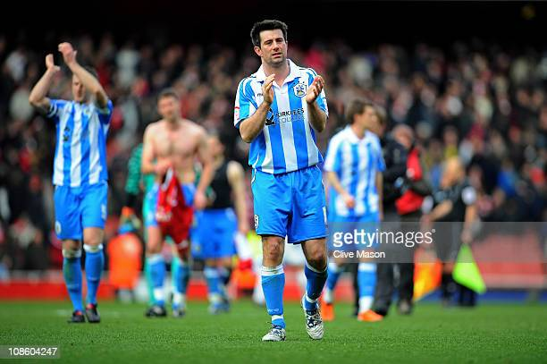 Huddersfield goalscorer Alan Lee applauds the travelling fans following their team's 321 defeat during the FA Cup sponsored by EON fourth round match...