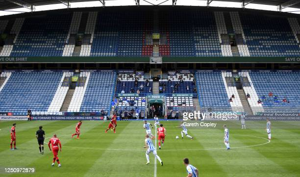 Huddersfield kick off the Sky Bet Championship match between Huddersfield Town and Wigan Athletic at John Smith's Stadium on June 20, 2020 in...