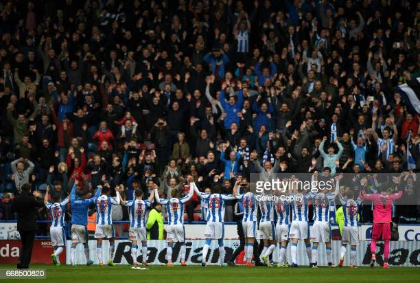 Huddersfield players celebrate with fans after winning the Sky Bet Championship match between Huddersfield Town and Preston North End at Galpharm...