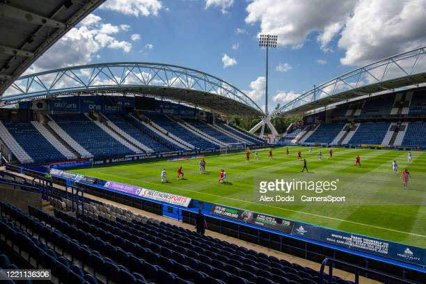 Huddersfield Town attack as empty stands are seen during the Sky Bet Championship match between Huddersfield Town and Wigan Athletic at John Smith's...