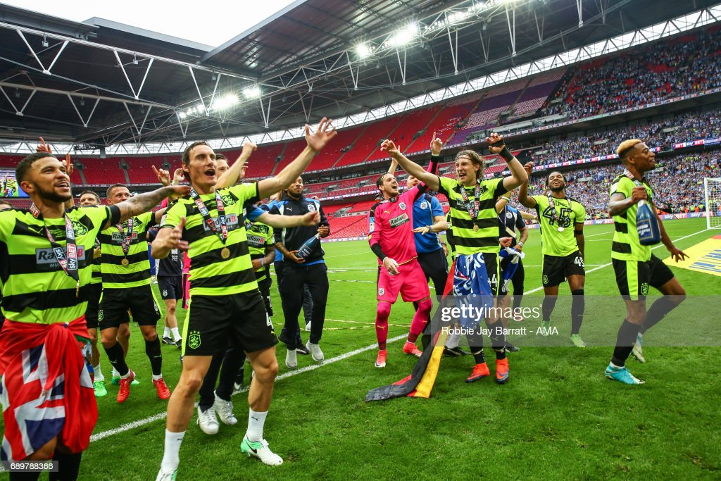 Huddersfield Town celebrate winning the play off final during the Sky Bet Championship Play Off Final match between Reading and Huddersfield Town at Wembley Stadium on May 29, 2017 in London, England.