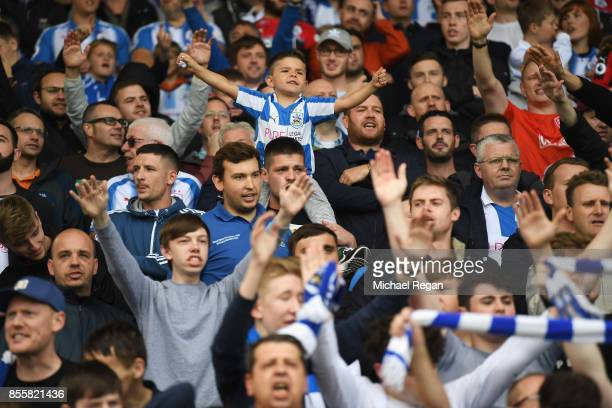 Huddersfield Town cheers on his team prior to the Premier League match between Huddersfield Town and Tottenham Hotspur at John Smith's Stadium on...