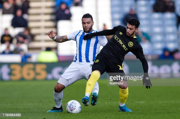 Huddersfield Town defender Danny Simpson and Brentford FC forward Sad Benrahma during the Sky Bet Championship match between Huddersfield Town and...