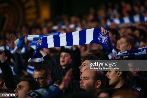 Huddersfield Town fan holds a blue and white scarf above his head during the Sky Bet Championship match between Huddersfield Town and Brighton Hove...
