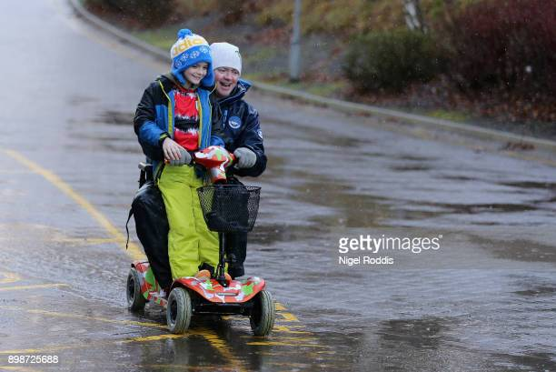 Huddersfield Town fans arrive at the stadium prior to the Premier League match between Huddersfield Town and Stoke City at John Smith's Stadium on...