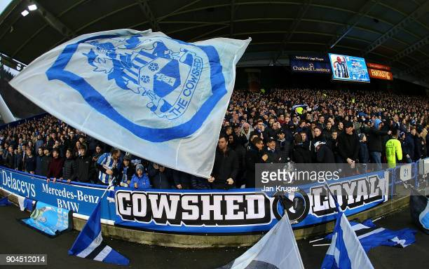 Huddersfield Town fans cheer on their team during the Premier League match between Huddersfield Town and West Ham United at John Smith's Stadium on...