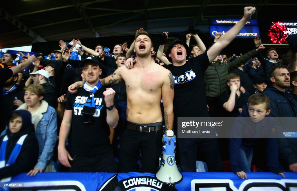 Huddersfield Town fans sing after the Premier League match between Huddersfield Town and Manchester United at John Smith's Stadium on October 21, 2017 in Huddersfield, England.