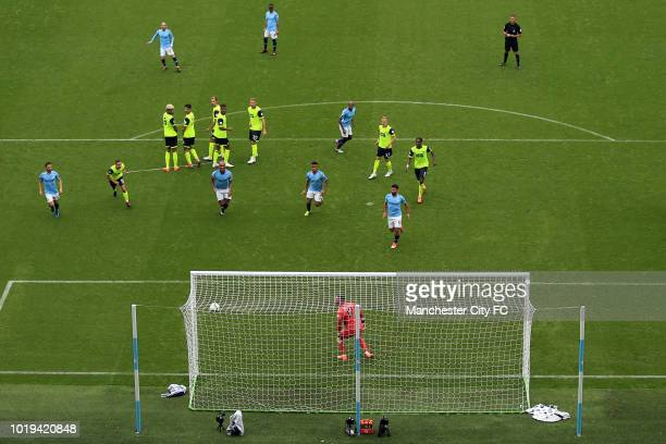 Huddersfield Town goalkeeper Ben Hamer looks on unable to stop a free kick from David Silva of Manchester City during the Premier League match...