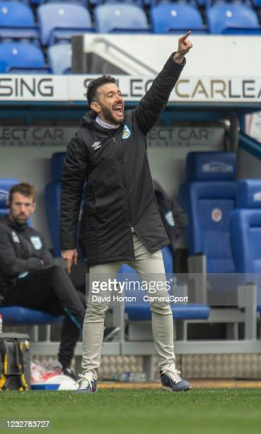 Huddersfield Town Head Coach Carlos Corberán shouts instructions to his team during the Sky Bet Championship match between Reading and Huddersfield...