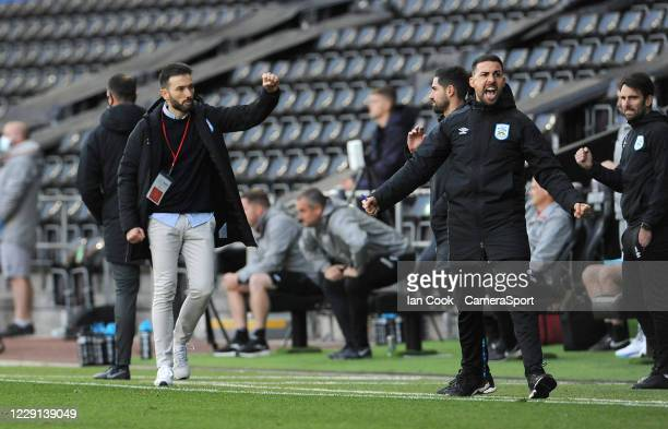 Huddersfield Town manager Carlos Corberán celebrates at the final whistle during the Sky Bet Championship match between Swansea City and Huddersfield...