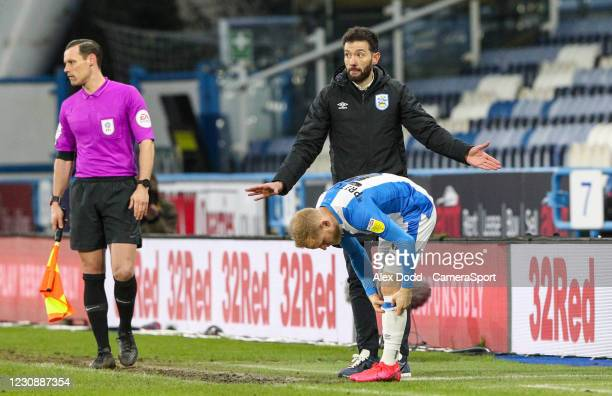 Huddersfield Town manager Carlos Corberán prepares to bring on Alex Pritchard during the Sky Bet Championship match between Huddersfield Town and...