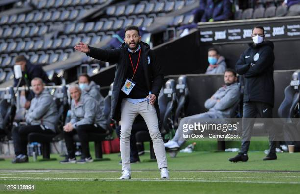 Huddersfield Town manager Carlos Corberán shouts instructions from the technical area during the Sky Bet Championship match between Swansea City and...