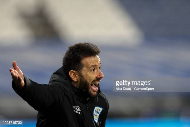 Huddersfield Town manager Carlos Corberán shouts instructions to his team from the technical area during the Sky Bet Championship match between...
