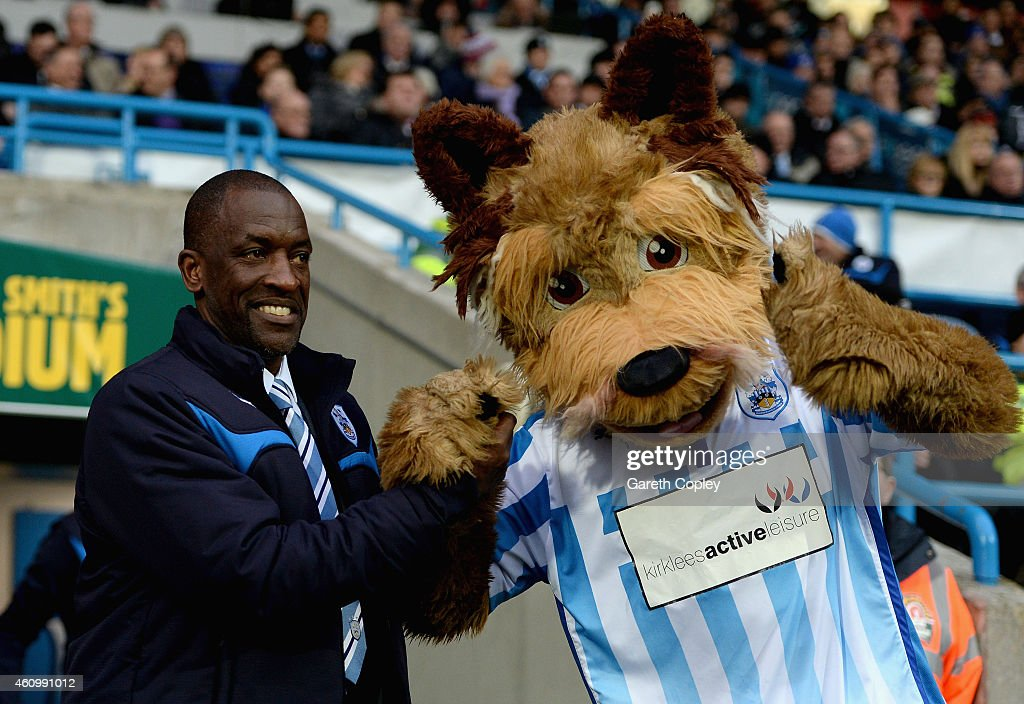 Huddersfield Town manager Chris Powell with Terry the Terrier ahead of the FA Cup Third Round match between Huddersfield Town and Reading at Galpharm Stadium on January 3, 2015 in Huddersfield, England.