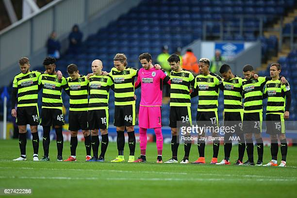 Huddersfield Town players acknowledge a minutes silence for the Chapecoense players before the Sky Bet Championship match between Blackburn Rovers...