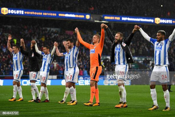 Huddersfield Town players celebrate after winning the Premier League match between Huddersfield Town and Manchester United at John Smith's Stadium on...
