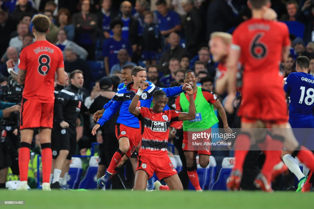Huddersfield Town players celebrate Premier League survival during the Premier League match between Chelsea and Huddersfield Town at Stamford Bridge on May 9, 2018 in London, England.