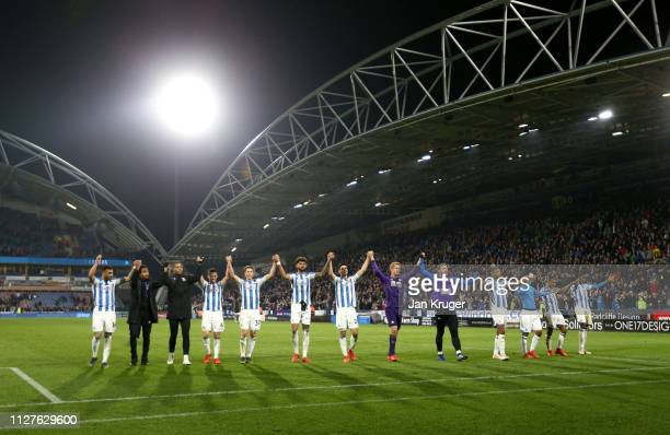 Huddersfield Town players celebrate victory after during the Premier League match between Huddersfield Town and Wolverhampton Wanderers at John...
