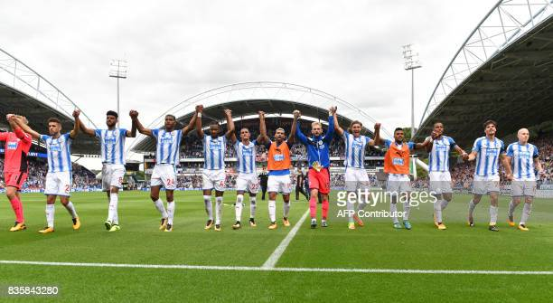 Huddersfield Town players celebrate victory during the English Premier League football match between Huddersfield Town and Newcastle United at the...