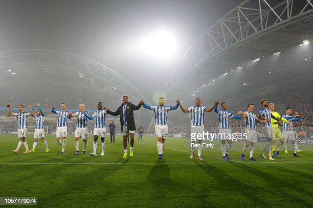 Huddersfield Town players celebrate with a winning wave during the Premier League match between Huddersfield Town and Fulham FC at John Smith's...