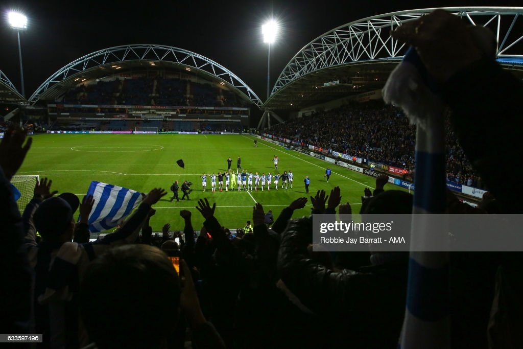 Huddersfield Town players celebrate with the fans at full time during the Sky Bet Championship match between Huddersfield Town and Brighton & Hove Albion at The John Smiths Stadium on February 2, 2017 in Huddersfield, England.