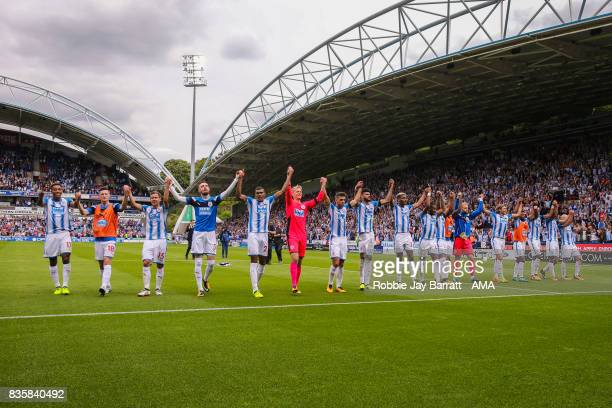 Huddersfield Town players celebrate with the fans at full time during the Premier League match between Huddersfield Town and Newcastle United at...