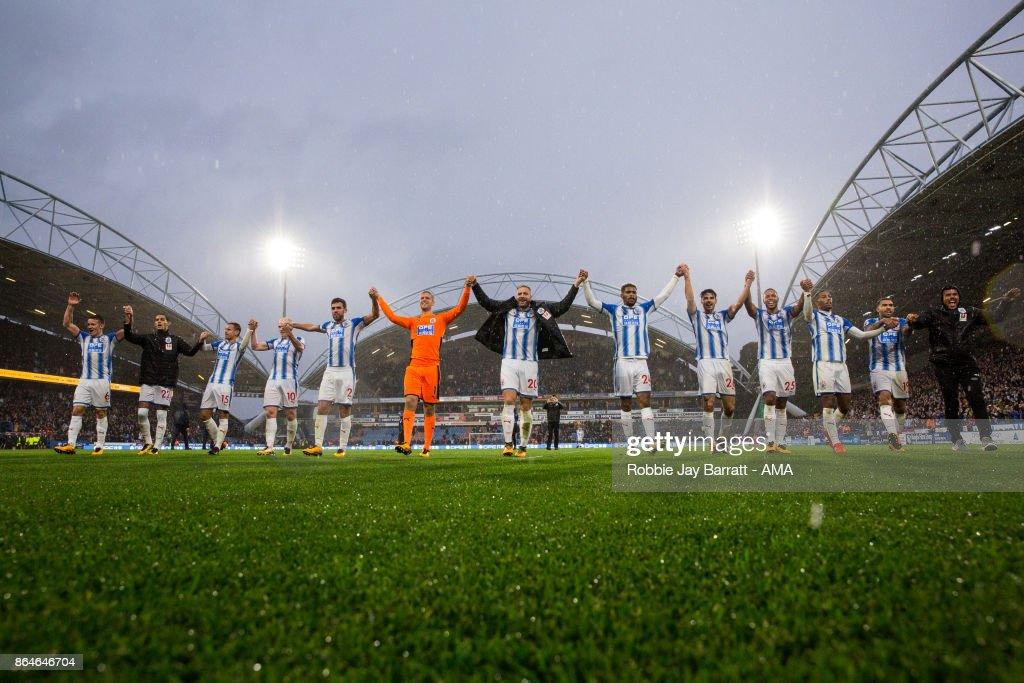 Huddersfield Town players celebrate with the fans at full time during the Premier League match between Huddersfield Town and Manchester United at John Smith's Stadium on October 21, 2017 in Huddersfield, England.