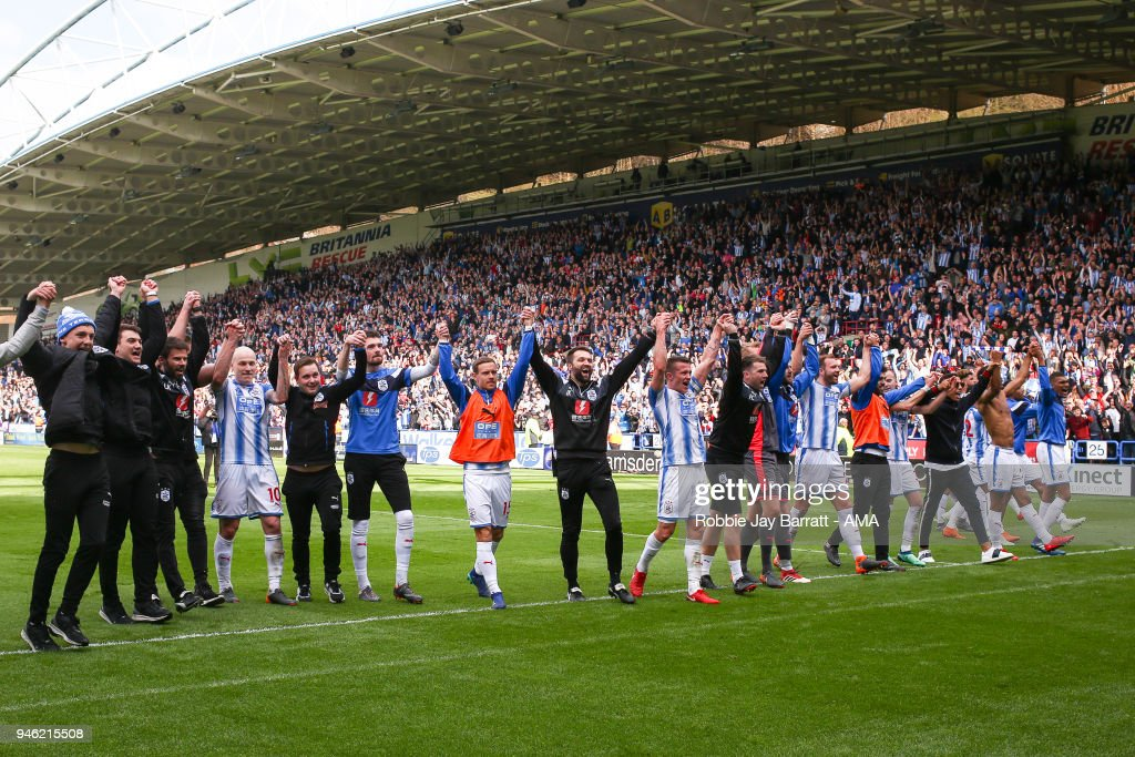 Huddersfield Town players celebrate with the fans at full time during the Premier League match between Huddersfield Town and Watford at John Smith's Stadium on April 14, 2018 in Huddersfield, England.