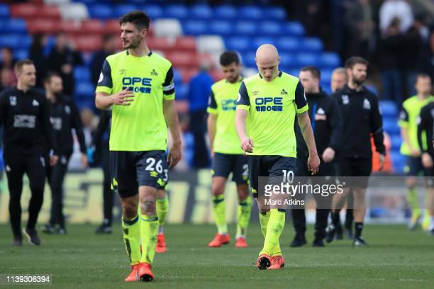 Huddersfield Town players look dejected as they leave the pitch following a loss which results in their relegation following the Premier League match...