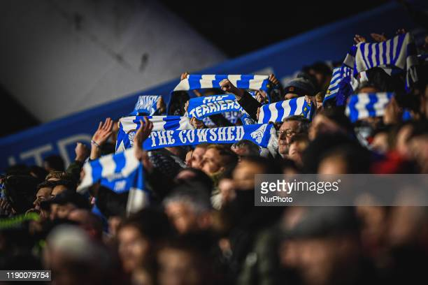 Huddersfield Town supporters hold up their scarfs during the Sky Bet Championship match between Huddersfield Town and Nottingham Forest at the John...
